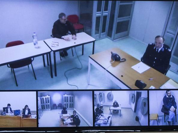 Carminati in video conferenza dal carcere di Parma (Ansa)